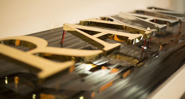 تابلو استیل طلایی